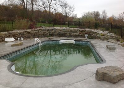 pool with armour stone retaining wall